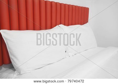 Bed with headboard and pillows