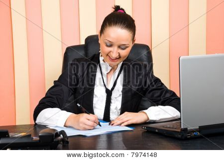 Young Executive Woman Writing On Papers