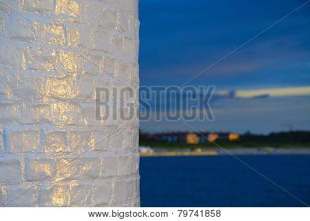 Wall Lighthouse Illuminated By The Setting Sun