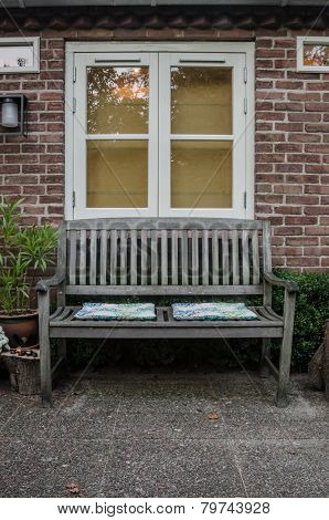 Bench And Window In Garden