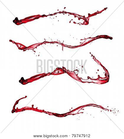 Isolated shot of red wine splashes on white background