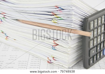 Brown Pencil Put In Stack Paperwork With Vertical Calculator