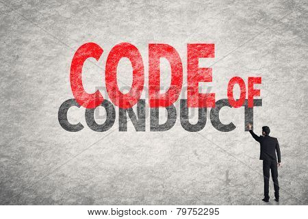 Asian business man write words on wall, Code Of Conduct