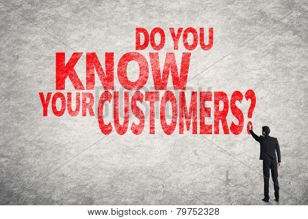 Asian business man write words on wall, Do you Know your Customers?
