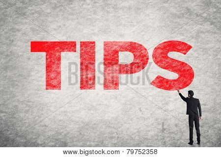 Asian business man write words on wall, Tips