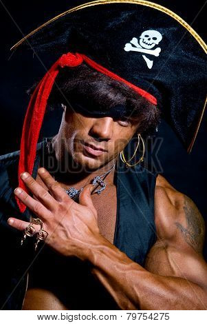 Close-up Portrait Muscular Pirate In The Studio On A Dark Background