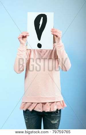 Woman Holding A Cardboard With Exclamation Mark