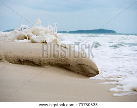 Waves crashing on the sand at the beach