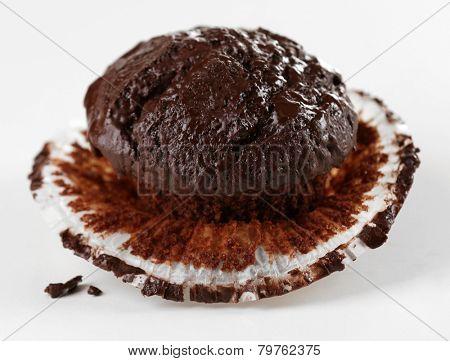 Yummy chocolate cupcake isolated on white