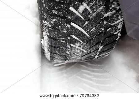 Car Tire In The Snow