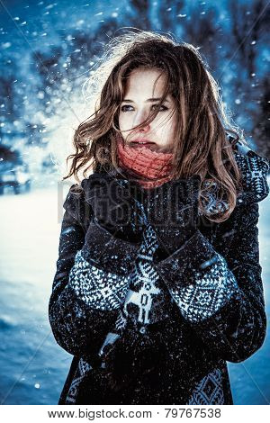 Beautiful Brunette Girl Blowing Star Dust - Winter Portrait