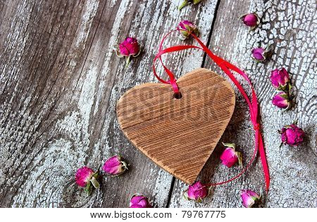 Wooden Heart With Red Ribbon And Small Dried Rosebuds
