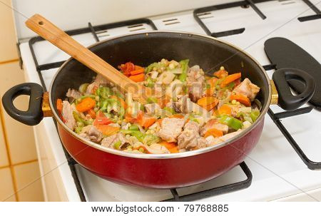 Stew meat in the pan.