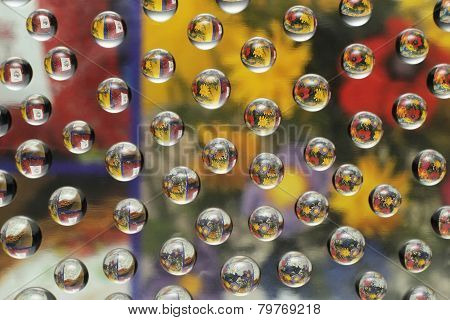 Colorful Flowers Through Water Drops On Glass