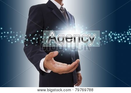 Businessman hand showing agency button.