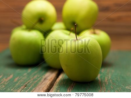 Green Apple Placed In The Fron Before Other Fruit