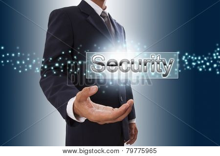 Businessman hand showing security button.