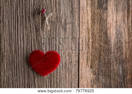 Love Heart Hanging On Wooden Texture Background