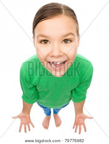 Portrait of a funny little girl asking what is going on, isolated over white