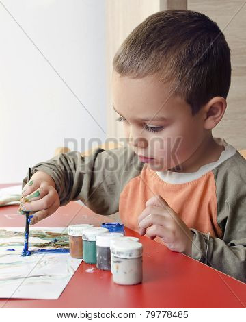 Child Painting With Brush And Colors