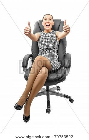 Business Woman Sitting On Chair And Showing Thumbs Up.