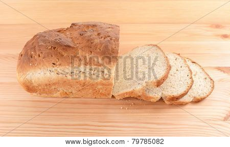 Crusty Loaf Of Fresh Bread And Three Slices