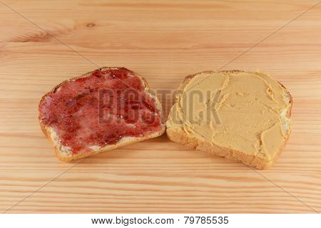 Slices Of Fresh Bread With Jelly And Peanut Butter