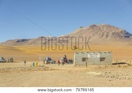 BOLIVIA, MAY 17, 2014: Tourists come to border control point near Bolivia/Chile border in the middle of desert