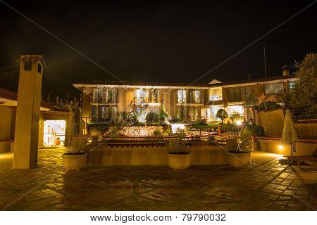 Upscale Hotel And Inviting Courtyard And Garden At Night On Lake Titikaka, Peru In South America