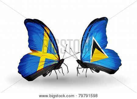 Two Butterflies With Flags On Wings As Symbol Of Relations Sweden And Saint Lucia