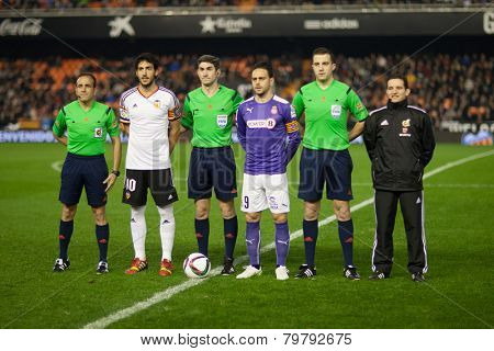VALENCIA, SPAIN - JANUARY 4: Referee Team and captains of the teams during Spanish King Cup match between Valencia CF and R.C.D. Espanyol at Mestalla Stadium on January 4, 2015 in Valencia, Spain
