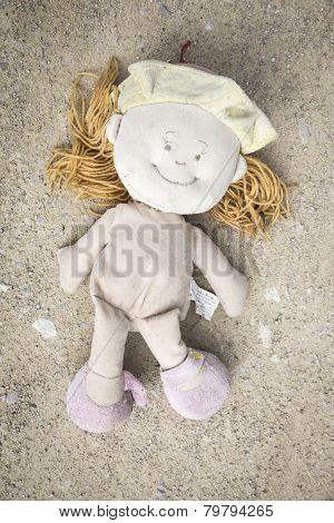 abandoned rag doll on the floor