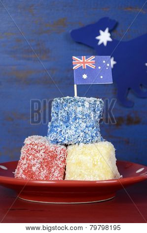 Happy Australia Day Red, White And Blue Lamingtons On Red And Blue Dark Recycled Wood Background. Ve