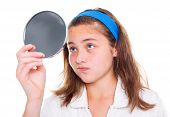 picture of pimples  - Teen girl examine her pimples in the mirror - JPG