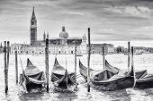 Постер, плакат: Gondolas In Front Of San Giorgio Maggiore Church B&w