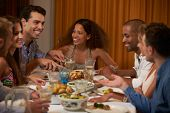 picture of food groups  - Group Of Friends Enjoying Dinner Party At Home Together - JPG