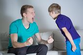 image of yell  - Image of young dad yelling at his son - JPG