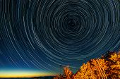 stock photo of north star  - Stars form trails as the Earth spins around the North Star.