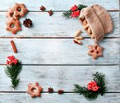 picture of hazelnut tree  - Cookies with nuts and sprigs of Christmas tree on color wooden background - JPG