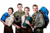 picture of sleeping bag  - Four young scouts members in uniform with sleeping bags - JPG
