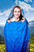 pic of sleeping bag  - Girl inside the blue sleeping bag traveling in the mountains - JPG