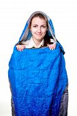 picture of sleeping bag  - Girl inside the blue sleeping bag isolated on white background - JPG