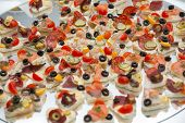 stock photo of buffet  - Different types of canapes on buffet table - JPG