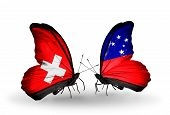 stock photo of samoa  - Two butterflies with flags on wings as symbol of relations Switzerland and Samoa - JPG