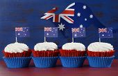 pic of red velvet cake  - Happy Australia Day January 26 party food with red velvet cupcakes with kangaroo flag on dark red and blue vintage rustic recycled wood background - JPG