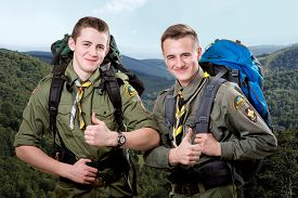 picture of boy scout  - Two young scout boys with sleeping bag and backpack traveling in the mountains - JPG