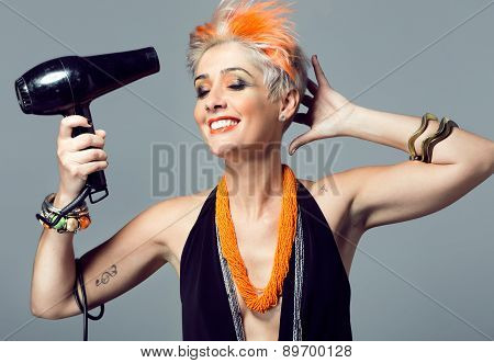 Beautiful Brunette Woman With Hair Dryer.
