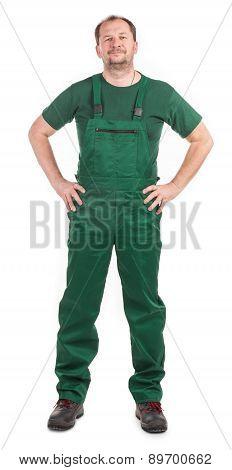 Worker in green overalls.