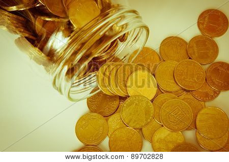 Coins Of Ukrainian Hryvnias And Dollars