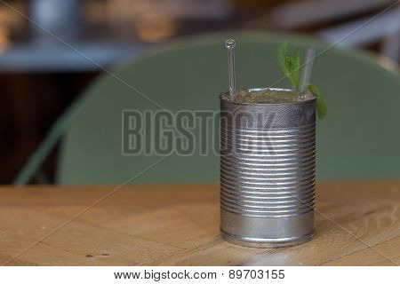 A Mojito With Mint Leaves In A Can